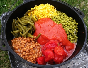 Dutch Oven Cowboy Stew with beans, corn, peas, tomatoes