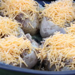 Sprinkle Cheese on the Top of Each Potato Boat