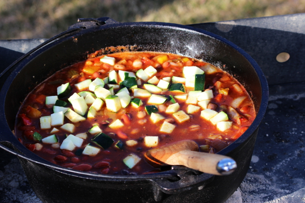 Beans and zucchini are added to the chili